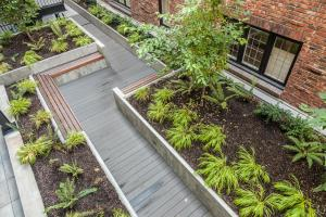 courtyard garden with benches and wooden walkway